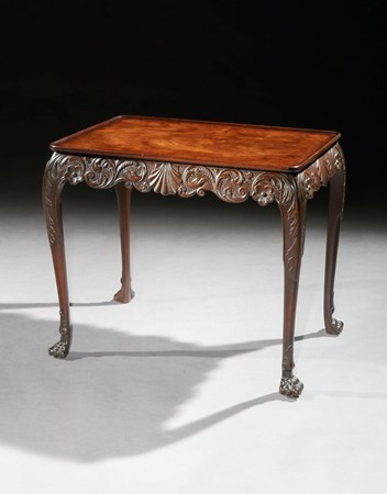 AN IRISH GEORGE II MAHOGANY SILVER TABLE