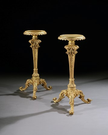 A PAIR OF GEORGE II GILTWOOD TORCHÈRES