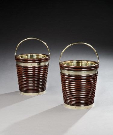 A PAIR OF GEORGE III BRASS-BOUND MAHOGANY PEAT BUCKETS