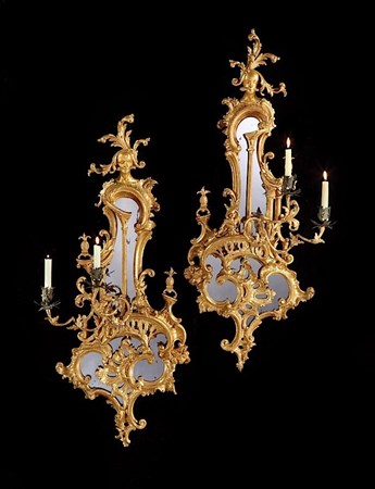 A PAIR OF GEORGE III GILTWOOD TWIN LIGHT GIRANDOLES IN THE MANNER OF THOMAS JOHNSON