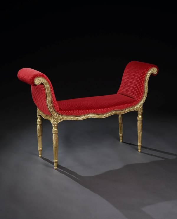 A PAIR OF GEORGE III GILTWOOD WINDOW SEATS