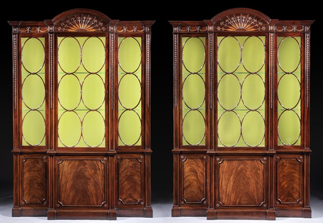 A PAIR OF GEORGE III MAHOGANY AND BOXWOOD BREAKFRONT LIBRARY BOOKCASES IN THE MANNER OF JOHN LINNELL