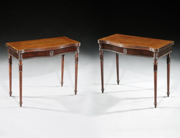 A PAIR OF GEORGE III MAHOGANY AND HAREWOOD CARD TABLES ATTRIBUTED TO MAYHEW & INCE
