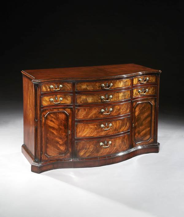 A PAIR OF GEORGE II MAHOGANY SERPENTINE COMMODES ATTRIBUTED TO WRIGHT AND ELWICK
