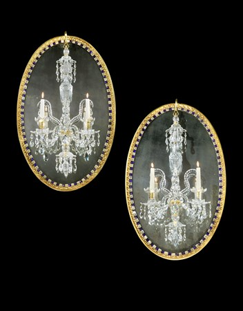 A PAIR OF IRISH GEORGE III OVAL GILTWOOD AND CUT GLASS MIRROR CHANDELIERS