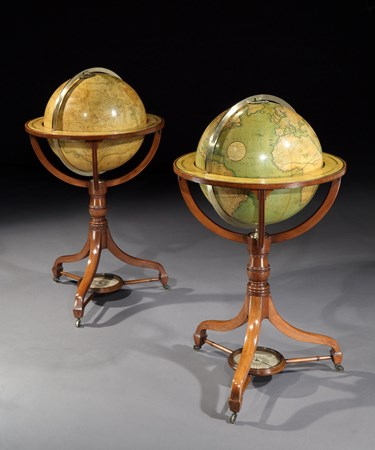 A PAIR OF REGENCY 18 INCH GLOBES BY J & W CARY ON MAHOGANY STANDS
