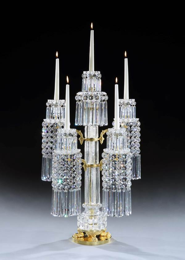A PAIR OF REGENCY ORMOLU MOUNTED CUT GLASS FIVE LIGHT CANDELABRA BY JOHN BLADES