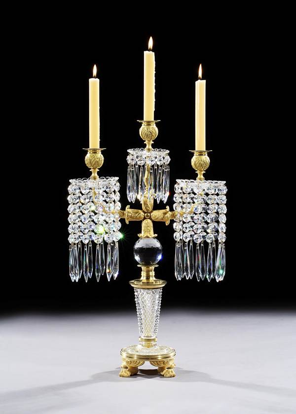 A PAIR OF REGENCY ORMOLU MOUNTED CUT GLASS THREE LIGHT CANDELABRA BY JOHN BLADES