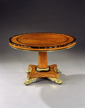 A REGENCY ORMOLU MOUNTED AMBOYNA CENTRE TABLE