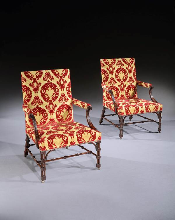 A SET OF FOUR GEORGE III MAHOGANY LIBRARY ARMCHAIRS