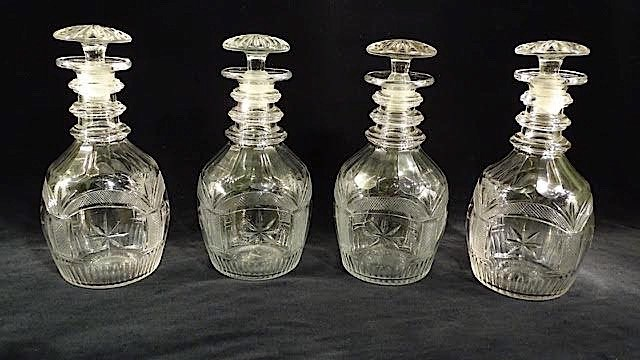 A SET OF FOUR REGENCY CUT GLASS DECANTERS