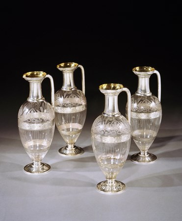 A SET OF FOUR VICTORIAN SILVER MOUNTED ETCHED GLASS CLARET JUGS BY EDWARD JOHN AND WILLIAM BARNARD