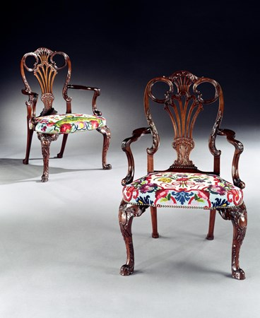 A RARE PAIR OF GEORGE III CARVED MAHOGANY ARMCHAIRS