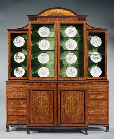 AN IMPORTANT GEORGE III INLAID BREAKFRONT BOOKCASE ATTRIBUTED TO MAYHEW AND INCE