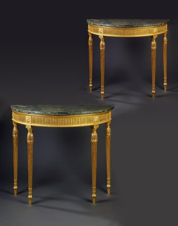 A PAIR OF GEORGE III GILTWOOD SEMI-CIRCULAR SIDE TABLES