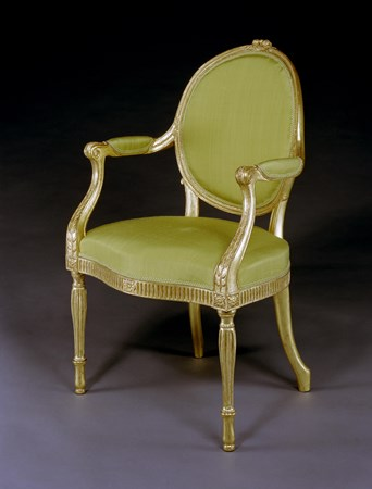 A GEORGE III GILTWOOD ARMCHAIR ATTRIBUTED TO THOMAS CHIPPENDALE