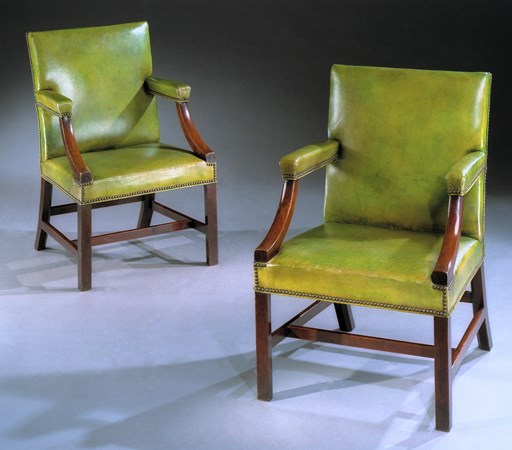 A PAIR OF GEORGE III MAHOGANY LIBRARY ARMCHAIRS