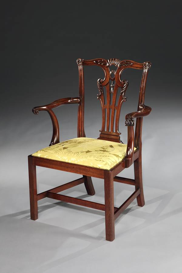 A SET OF TEN GEORGE II MAHOGANY DINING CHAIRS