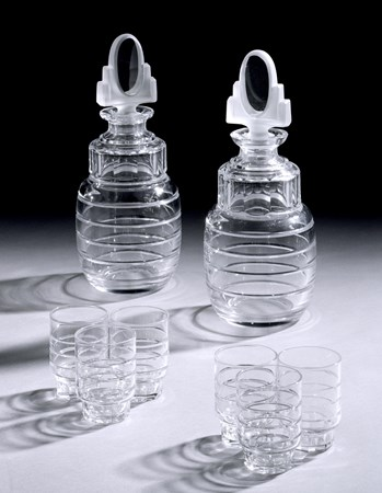 AN ART DECO SET OF DECANTERS AND GLASSES BY VAL SAINT LAMBERT