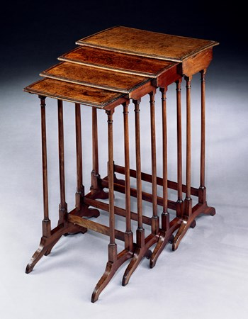 A REGENCY NEST OF AMBOYNA TABLES
