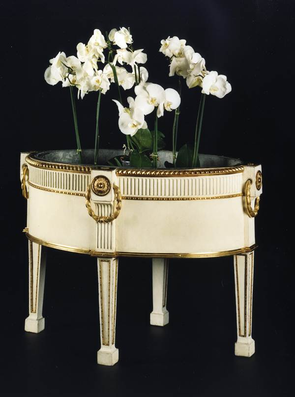A GEORGE III ORMOLU MOUNTED WHITE PAINTED OVAL WINE COOLER
