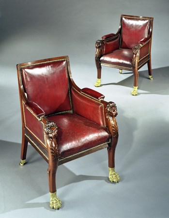 AN IMPORTANT PAIR OF REGENCY CARVED MAHOGANY LIBRARY BERGÈRES