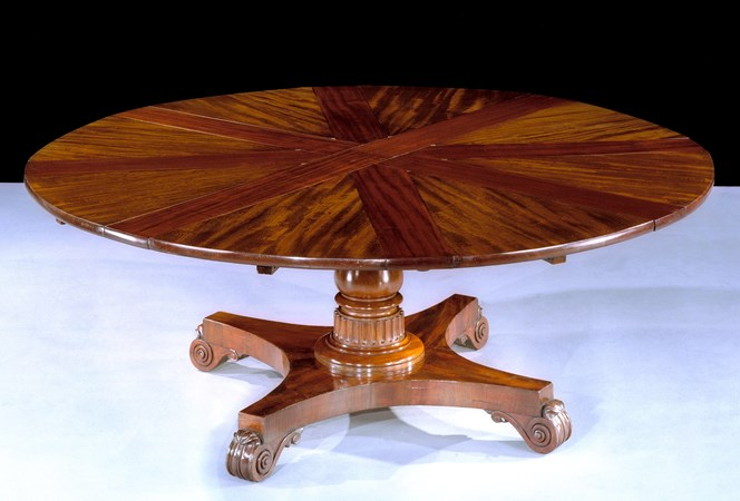 A WILLIAM IV EXTENDING CIRCULAR DINING TABLE BY ROBERT JUPE