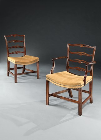 A SET OF SIXTEEN GEORGE III MAHOGANY LADDER BACK DINING CHAIRS