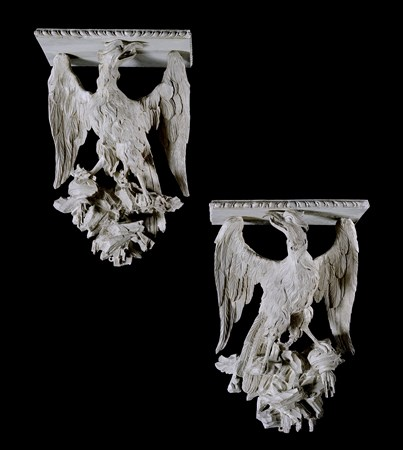 A PAIR OF IRISH GEORGE II CARVED WOOD AND PAINTED EAGLE WALL BRACKETS