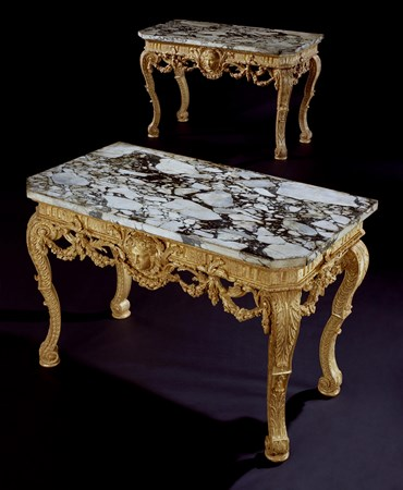 A PAIR OF GEORGE II CARVED GILTWOOD SIDE TABLES ATTRIBUTED TO THOMAS VARDY, TO A DESIGN OF JOHN VARDY