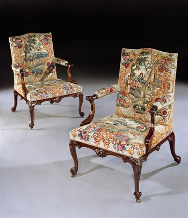 A PAIR OF GEORGE III MAHOGANY NEEDLEWORK LIBRARY ARMCHAIRS