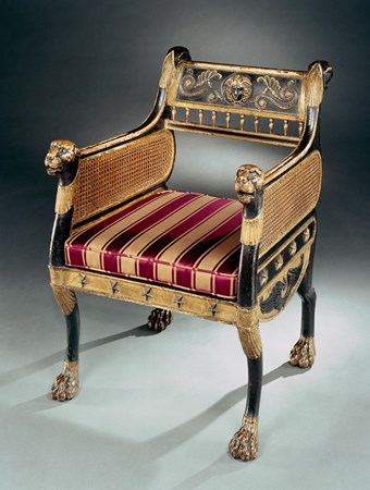 THE FORDE ABBEY CHAIR. A REGENCY EBONSIED AND PARCEL GILT ARMCHAIR DESIGNED BY GEORGE SMITH.