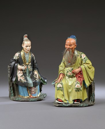 A PAIR OF GEORGE III PERIOD CHINESE EXPORT 'NODDING HEAD' SEATED FIGURES