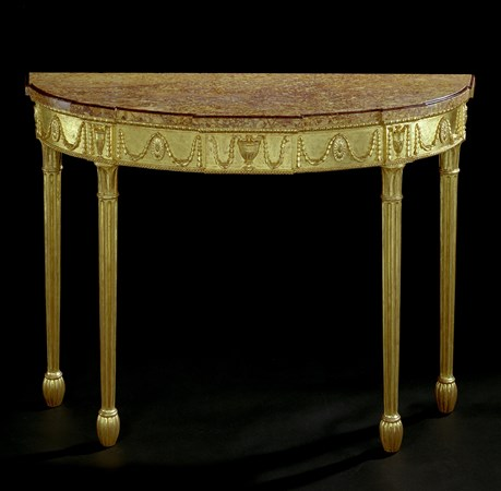 A GEORGE III CARVED GILTWOOD SIDE TABLE