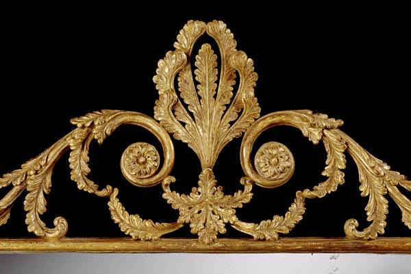 A GEORGE III CARVED GILTWOOD OVERMANTEL MIRROR