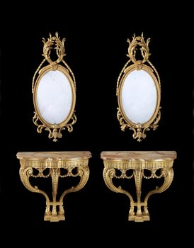 A PAIR OF GEORGE III GILTWOOD CONSOLE TABLES EN SUITE WITH A PAIR OF GILTWOOD OVAL MIRRORS