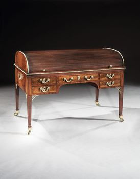 A GEORGE III BRASS MOUNTED MAHOGANY TAMBOUR ROLL-TOP WRITING TABLE ATTRIBUTED TO GILLOWS