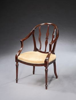 A GEORGE III MAHOGANY OPEN ARMCHAIR ATTRIBUTED TO JOHN LINNELL