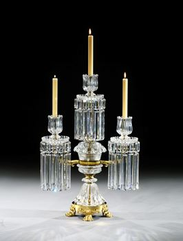 A REGENCY ORMOLU MOUNTED CUT GLASS THREE LIGHT CANDELABRUM BY JOHN BLADES