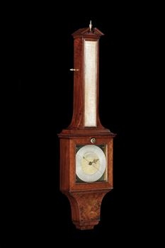 A GEORGE III MAHOGANY WHEEL BAROMETER BY GEORGE ADAMS