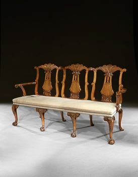 A GEORGE II WALNUT TRIPLE BACK SETTEE ATTRIBUTED TO GILES GRENDEY