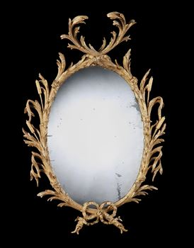 A GEORGE II GILTWOOD OVAL MIRROR ATTRIBUTED TO JOHN LINNELL