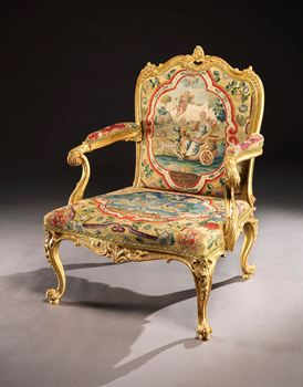 A GEORGE II GILTWOOD OPEN ARMCHAIR ATTRIBUTED TO MAYHEW & INCE