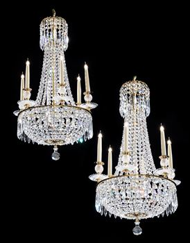 A SMALL PAIR OF REGENCY CUT GLASS SIX LIGHT CHANDELIERS BY JOHN BLADES