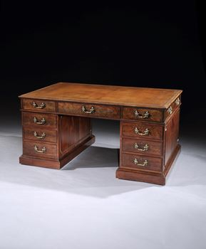 A GEORGE III MAHOGANY LIBRARY DESK BY THOMAS CHIPPENDALE