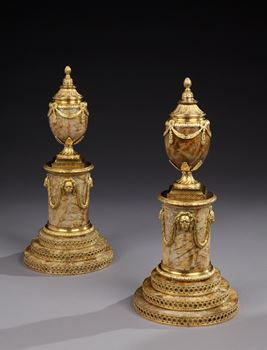 A PAIR OF GEORGE III ORMOLU MOUNTED TIGER STONE CANDLE VASES BY MATTHEW BOULTON
