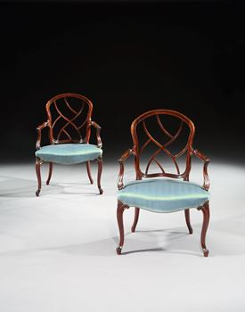 A PAIR OF GEORGE III MAHOGANY LATTICE BACK HEPPLEWHITE PERIOD OPEN ARMCHAIRS