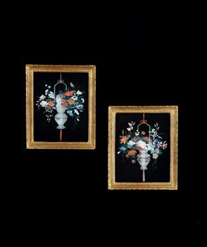 A PAIR OF GEORGE III REVERSE GLASS PAINTINGS