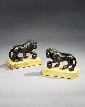 A PAIR OF GEORGE III BRONZE AND SIENNA MARBLE MODELS OF THE MEDICI LIONS