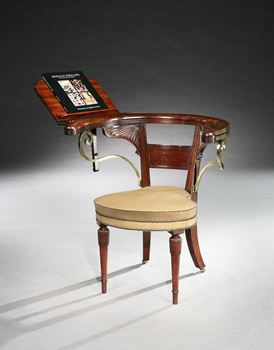 A REGENCY BRASS MOUNTED MAHOGANY READING CHAIR